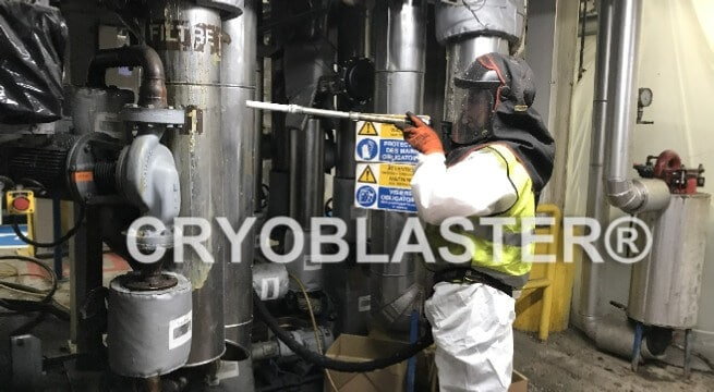 Dry ice blasting operator cleaning glue on industrial process